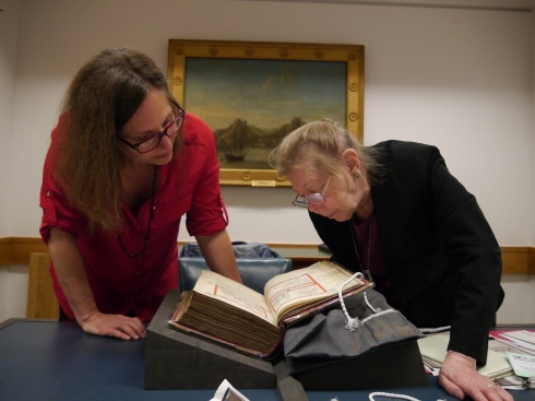 Professor Kathryn A. Smith and Professor Emerita Lucy Freeman Sandler examining a manuscript in London, May 2014