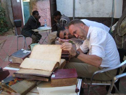 Prof. Flood examining Qur'an manuscripts, Sherif Harar City Museum, Harar, Ethiopia (photo Sana Mirza)